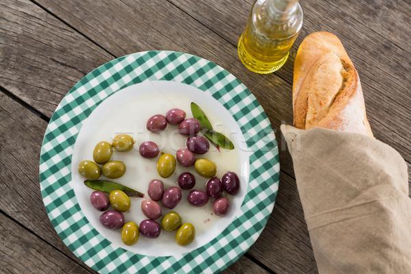 Gemarineerd olijven olie brood houten tafel voedsel Stockfoto © wavebreak_media