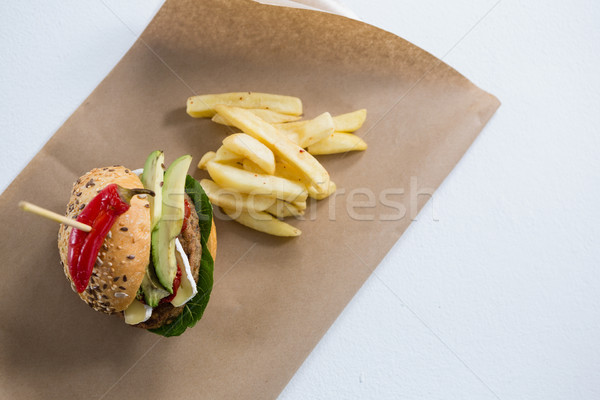 Overhead view of burger with French fries on paper Stock photo © wavebreak_media