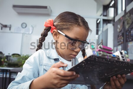 Elementary schoolgirl using microscope at laboratory Stock photo © wavebreak_media