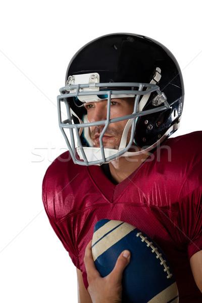 Amerikai futballista visel sisak tart labda Stock fotó © wavebreak_media