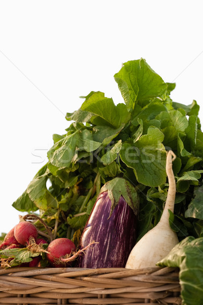 Various vegetables in wicker basket against white background Stock photo © wavebreak_media
