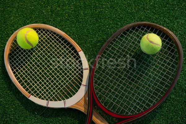Overhead view of tennis balls on rackets Stock photo © wavebreak_media