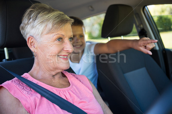 Grandmother driving a car while grandson sitting in the back seat Stock photo © wavebreak_media