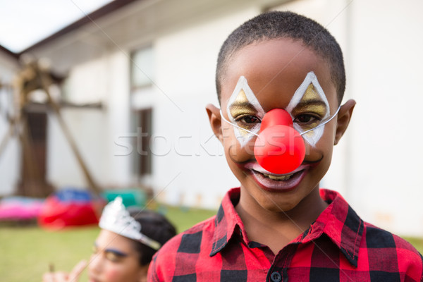Portrait garçon visage peinture clown Photo stock © wavebreak_media