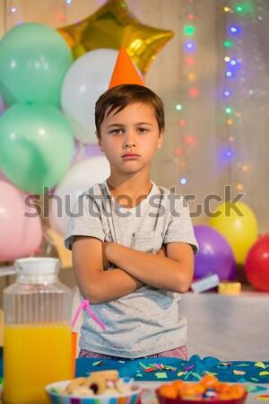 Cute boy standing with birthday cake Stock photo © wavebreak_media