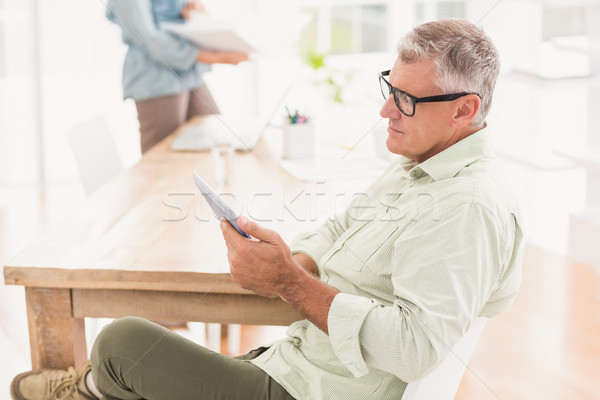 Attentive businessman working on a tablet Stock photo © wavebreak_media