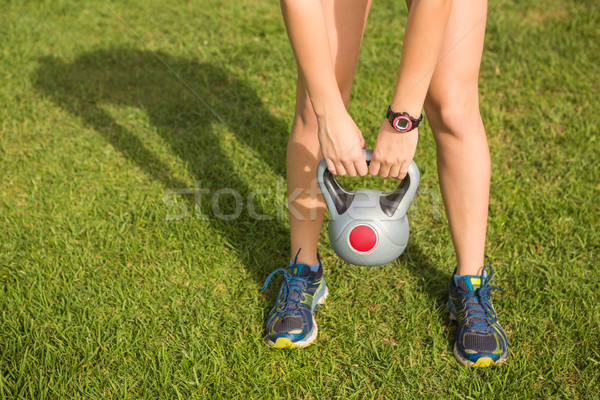Sporty woman exercising with kettlebell  Stock photo © wavebreak_media