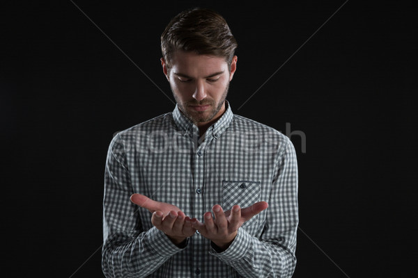 Man pretending to hold an invisible object Stock photo © wavebreak_media