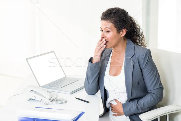 Terhes üzletasszony másfelé néz ásít fáradt iroda Stock fotó © wavebreak_media