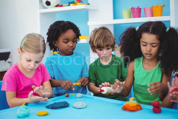 Gülen oynayan çocuklar kil büro mutlu tablo Stok fotoğraf © wavebreak_media