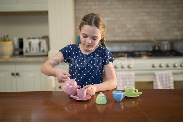 Young girl pouring tea in the cups Stock photo © wavebreak_media