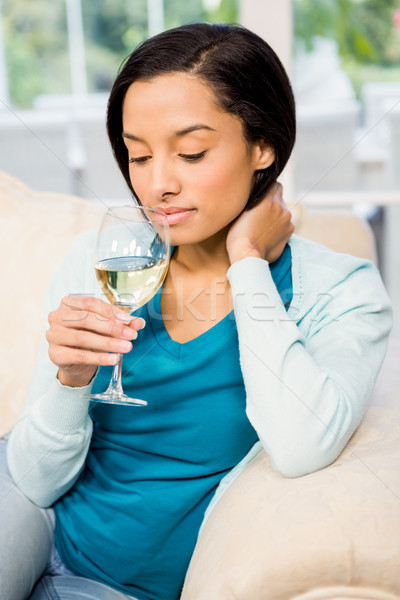 Peaceful brunette up to drink white whine Stock photo © wavebreak_media