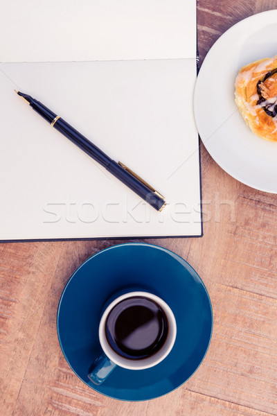 High angle view of pen on notepad by food and coffee at table  Stock photo © wavebreak_media