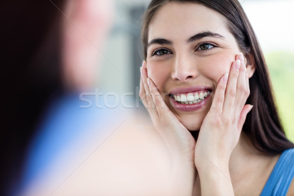 Smiling brunette in bathroom Stock photo © wavebreak_media