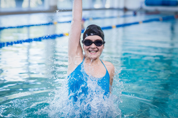 Encajar mujer brazo piscina agua Foto stock © wavebreak_media