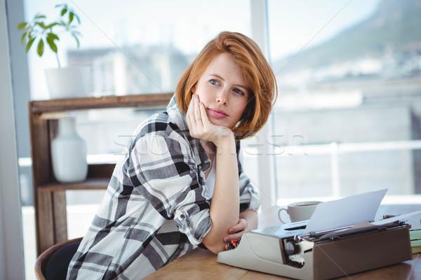 hipster woman sitting at her typewriter, thinking Stock photo © wavebreak_media