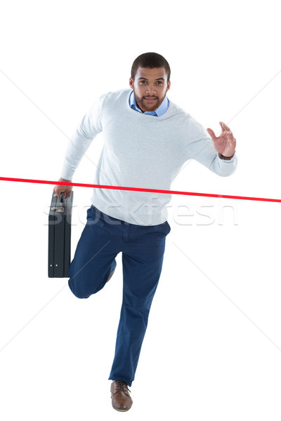 Masculina ejecutivo maletín ejecutando jóvenes Foto stock © wavebreak_media
