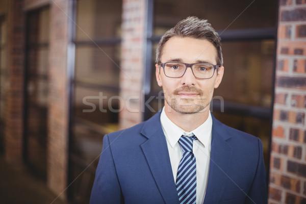 Işadamı ayakta ofis portre gözlük Stok fotoğraf © wavebreak_media