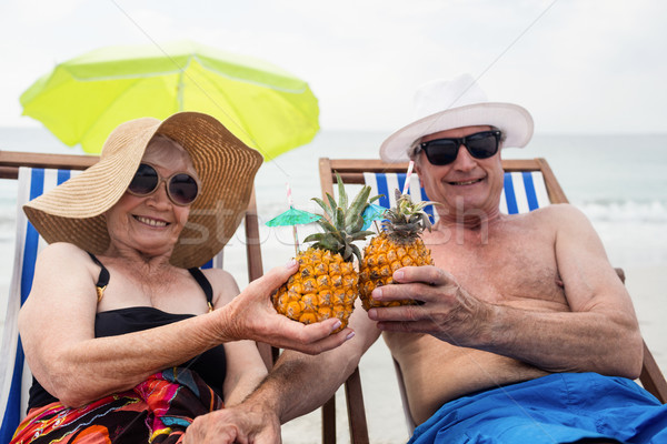 Boldog idős pár megnyugtató ül pirít ananász Stock fotó © wavebreak_media