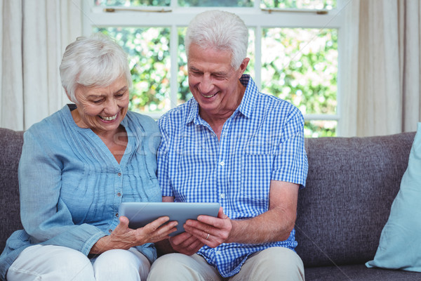 Smiling retired couple using tablet  Stock photo © wavebreak_media