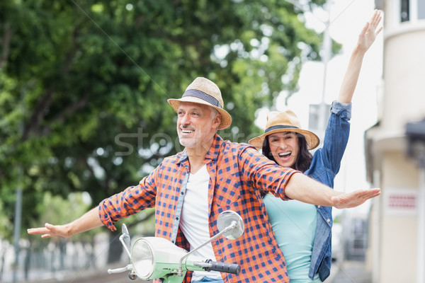 Happy couple with arms outstretched Stock photo © wavebreak_media