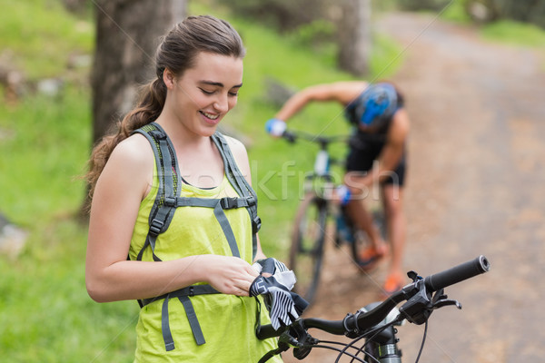 Young woman wearing gloves on footpath Stock photo © wavebreak_media