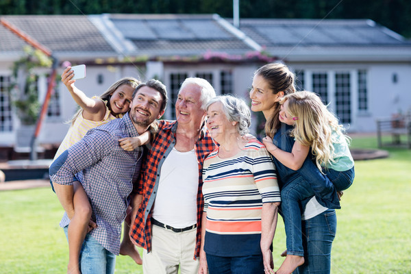 Multi-generation family taking a selfie in garden Stock photo © wavebreak_media