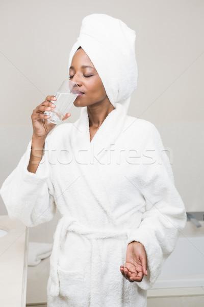 Beautiful woman having medicine Stock photo © wavebreak_media