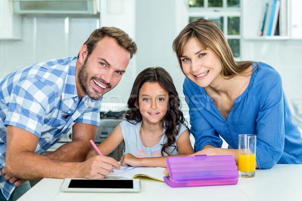 Szczęśliwy ojciec matka córka praca domowa domu Zdjęcia stock © wavebreak_media