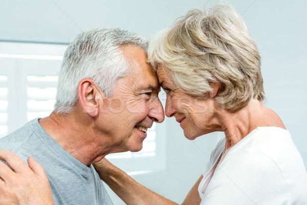 Oldalnézet boldog idős pár áll szemtől szembe hálószoba Stock fotó © wavebreak_media