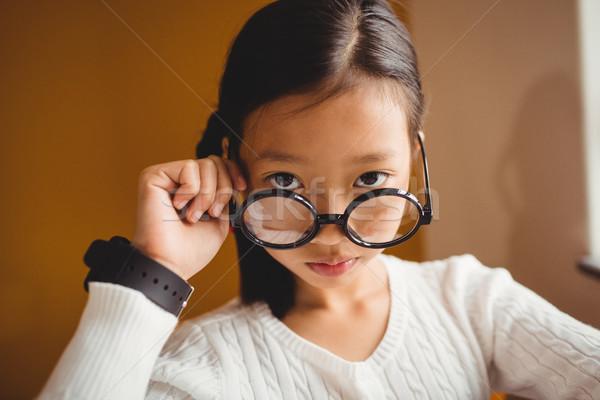 Schoolchild holding her glasses Stock photo © wavebreak_media