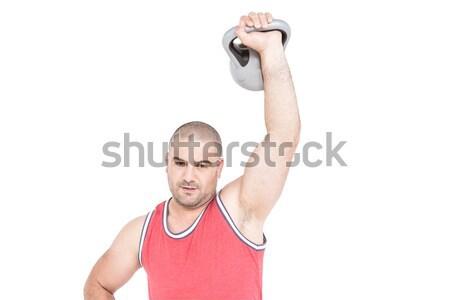 Bodybuilder pesante kettlebell ritratto bianco Foto d'archivio © wavebreak_media