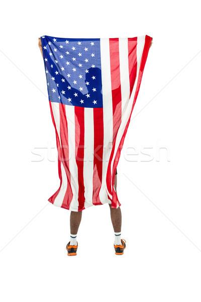Atleta posa bandiera americana vittoria bianco bandiera Foto d'archivio © wavebreak_media