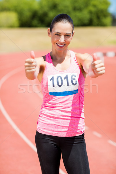 Portrait of female athlete showing her thumbs up Stock photo © wavebreak_media