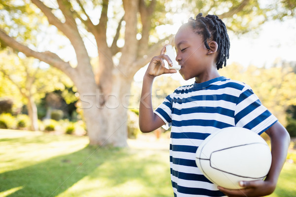 Focus on child holding an object Stock photo © wavebreak_media