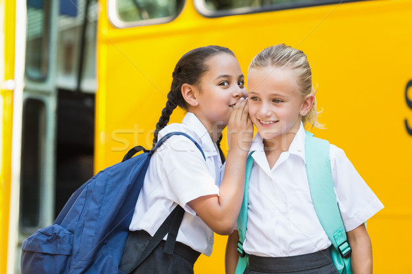 Sorridente aluna amigos ouvido fonte Foto stock © wavebreak_media