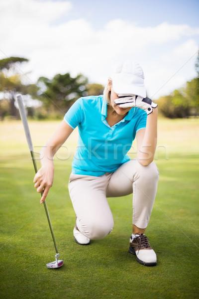 Mulher ocultação cara campo de golfe sorridente Foto stock © wavebreak_media