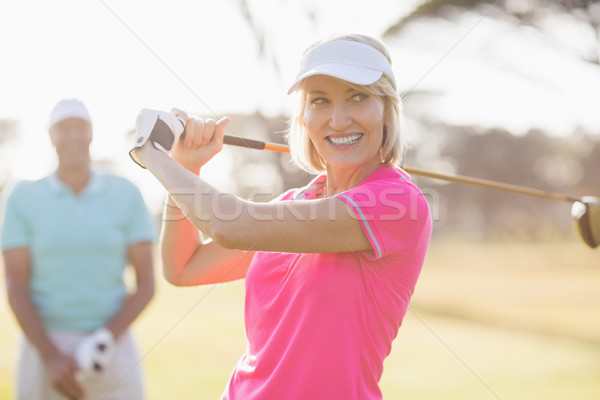 Confident mature woman carrying golf club by man  Stock photo © wavebreak_media