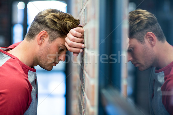 Stressed man leaning on wall Stock photo © wavebreak_media