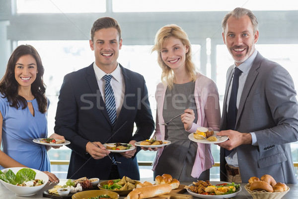 Portrait of business colleagues serving themselves at buffet lun Stock photo © wavebreak_media