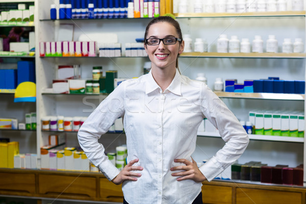 Pharmacist standing with hand on hip in pharmacy Stock photo © wavebreak_media