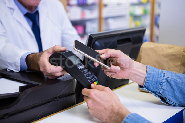 клиентов оплата смартфон компьютер человека Сток-фото © wavebreak_media