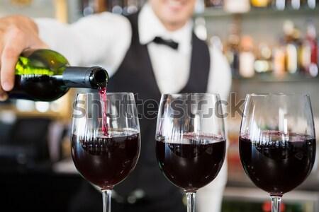 Csapos áramló vörösbor üveg középső rész bár Stock fotó © wavebreak_media