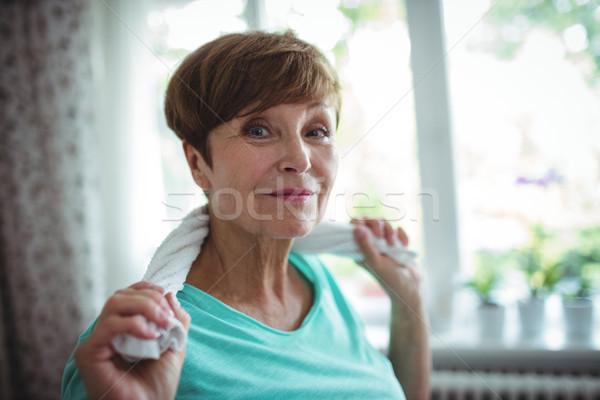 Idős nő tart törölköző körül nyak Stock fotó © wavebreak_media