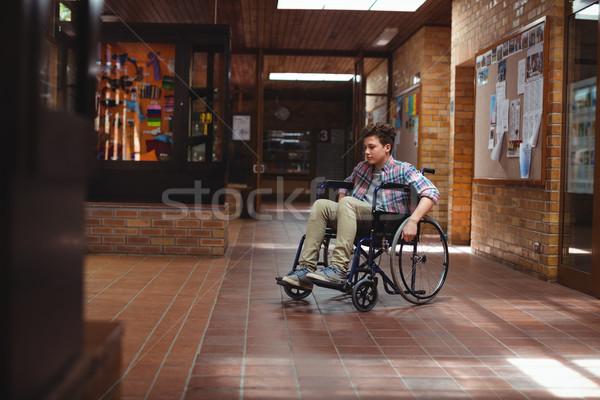Niepełnosprawnych uczeń wózek korytarz szkoły zamyślony Zdjęcia stock © wavebreak_media