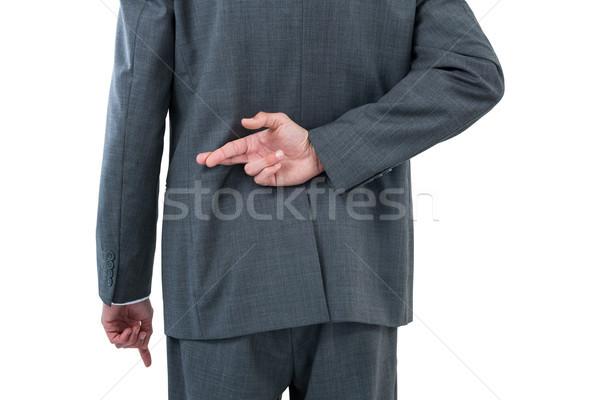 Businessman standing with figure crossed Stock photo © wavebreak_media
