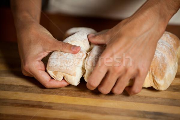 Male staff tearing a bun in bakery shop Stock photo © wavebreak_media