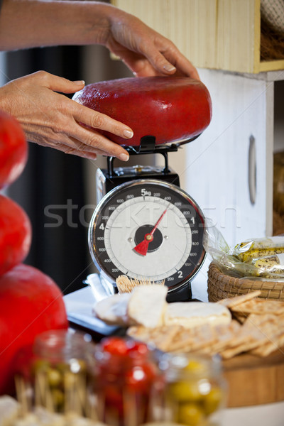 Hands of female staff weighing gouda cheese at counter Stock photo © wavebreak_media