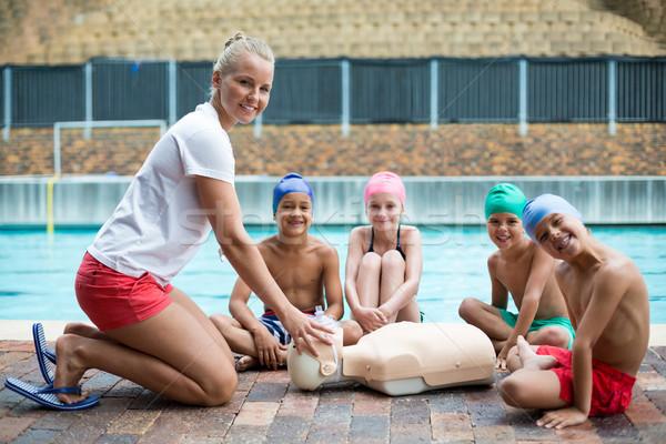 Bambini istruttore salvataggio formazione ragazza felice Foto d'archivio © wavebreak_media