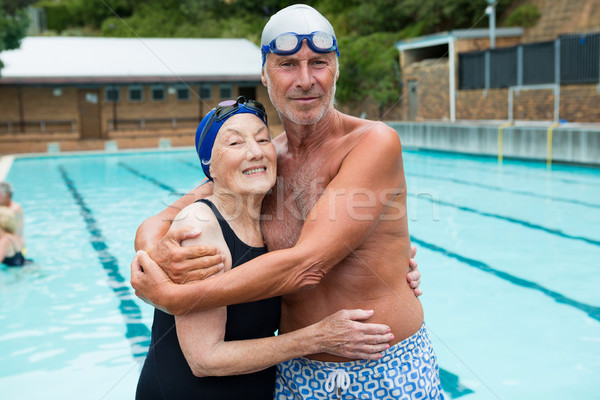 Senior couple embracing each other at poolside Stock photo © wavebreak_media